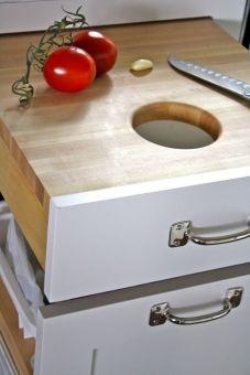 kitchen cutting board over trash bin