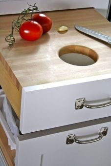 kitchen cutting board over trash bin
