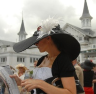 Colleen Rice, of Louisville, Ky., reads a race program in the paddock area during the 134th Kentucky Derby Saturday, May 3, 2008, at Churchill Downs in Louisville, Ky.  (AP Photo/Patti Longmire)
